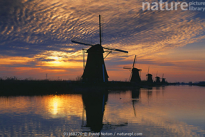 Sunrise over the windmills at Kinderdijk, Holland  ,  COUNTRYSIDE,EUROPE,LANDSCAPES,REFLECTIONS,SILHOUETTES,SUNRISE,WATER,WINDMILL  ,  David Noton