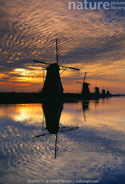 Sunrise over the windmills at Kinderdijk, Holland  ,  CLOUDS,EUROPE,LANDSCAPES,REFLECTIONS,SILHOUETTES,SUNRISE,VERTICAL,WATER,WINDMILL,Weather  ,  David Noton