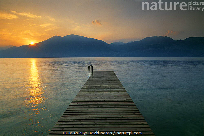 Boat jetty nr Brenzone, Lake Garda, Lombardy, Italy  ,  ATMOSPHERIC,EUROPE,LAKES,LANDSCAPES,MOUNTAINS,PEACEFUL,SUNRISE,Concepts  ,  David Noton