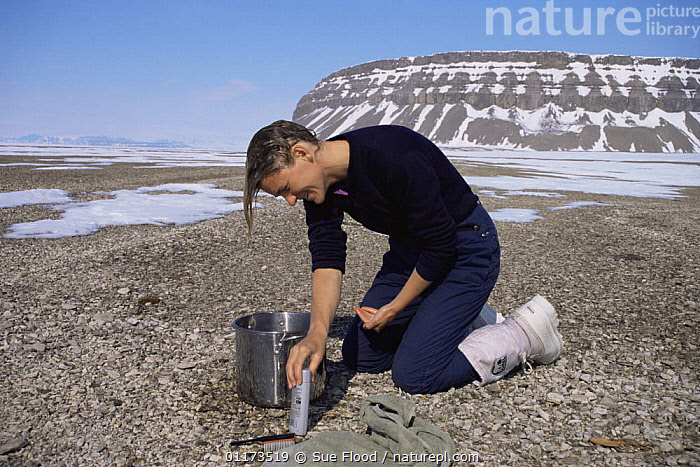 Producer Martha Holmes washing her hair in the Canadian Arctic, May 1998, on location for BBC NHU Blue Planet series, BATHING,CANADA,PEOPLE,SNOW,SUMMER,North America, Sue Flood