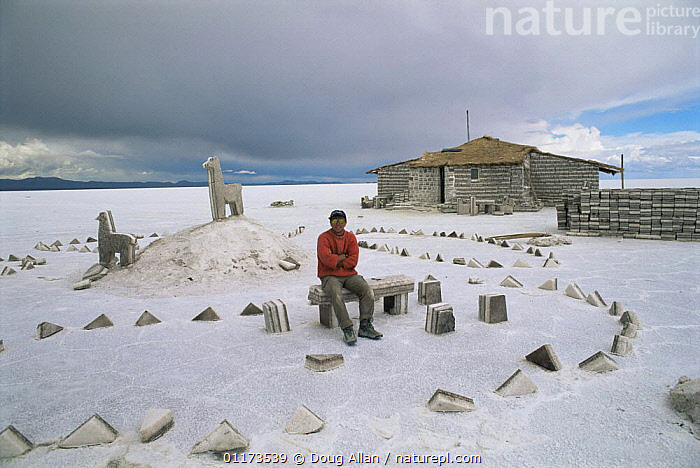 Doug Allan outside hotel made entirely of blocks of salt while filming for BBC NHU 'The Blue Planet'. Salar de Uyani, Bolivia 1997, BOLIVIA,BUILDINGS,DESERTS,LANDSCAPES,MINERALS,PEOPLE,SOUTH AMERICA, Doug Allan