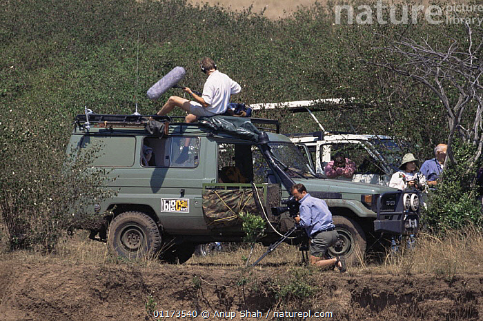 Film crew filming and sound recording for BBC NHU 'Big Cat Diary', Masai Mara GR, Kenya, CAMERA,CAMERAMAN,EAST AFRICA,FILMING IN WILD,PEOPLE,RESERVE,SAVANNA,SOUND RECORDING,VEHICLES,Africa,Grassland, Anup Shah