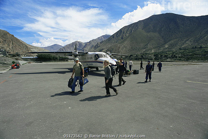 Film crew for BBC NHU 'Planet Earth - Mountains' arrive at Jomosom airstrip, Himalayas, Nepal, c 2004, AEROPLANE,AIRPLANE,ASIA,LANDSCAPES,NEPAL,PEOPLE,PLANET EARTH   MOUNTAINS, Barrie Britton