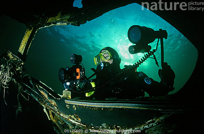 Diving photographer photographing underwater wreck  ,  CAMERA,PEOPLE,PHOTOGRAPHY,SHIPWRECK  ,  Alan James