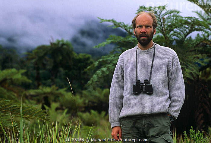 """Producer Neil Nightingale on location in the central higlands of New Guinea, filming for BBC television programme """"New Guinea, An Island Apart"""" 1991  ,  BBC,BINOCULARS,BIRD WATCHING,CLOUDS,FORESTS,MIST,NHU,PEOPLE,PORTRAITS,PRODUCERS,VERTICAL,Weather  ,  Michael Pitts"""