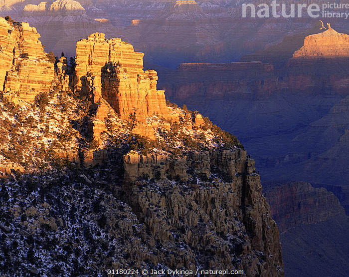 """Rock formation known as """"Sinking Ship"""" with """"Angel's Gate"""" in the background in a light covering of snow at dawn, Grand Canyon NP, Arizona, USA, canyons,DAWN,LANDSCAPES,north america,NORTH AMERICA,RESERVE,ROCK FORMATIONS,SNOW,SUNRISE,TREES,USA,valleys,Geology,Plants, Jack Dykinga"""
