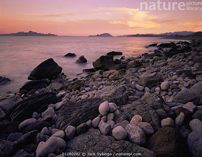 Lava and pepple beach at sunset with islands in the distance, Sea of Cortez, Baja California Sur, Mexico, Central America, ATMOSPHERIC,BEACHES,central america,CENTRAL AMERICA,COASTS,DUSK,LANDSCAPES,Lava,MEXICO,PEACEFUL,ROCKS,SUNSET,WATER,Concepts,USA,CENTRAL-AMERICA,North America, Jack Dykinga