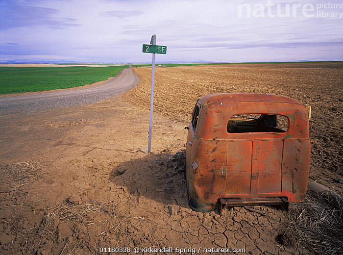Abandoned vehicle by the side of a rural intersection, Douglas County, Washington, USA, CARS,CLOUDS,FIELDS,LANDSCAPES,NORTH AMERICA,NORTH AMERICA,REFUSE,ROADS,SIGNS,USA,VEHICLES,Weather, Kirkendall-Spring