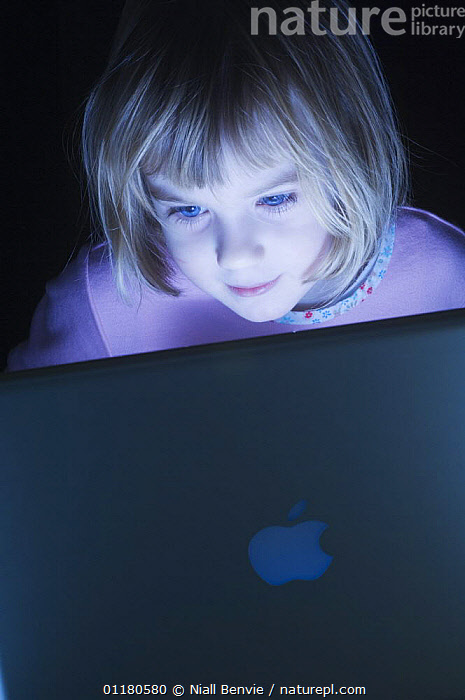 Girl, 4, engrossed by a computer, December, Scotland, UK - model released  ,  BEHAVIOUR,CHILD,CHILDREN,COMPUTERS,EUROPE,PEOPLE,PRIMATES,SCOTLAND,VERTEBRATES,VERTICAL,Mammals  ,  Niall Benvie