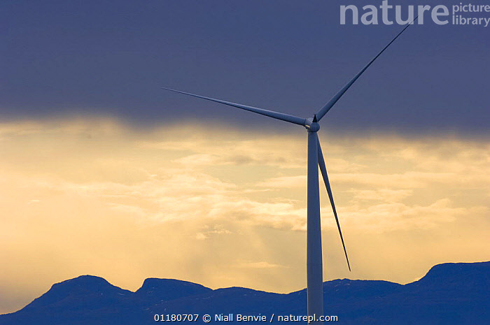 Wind turbines with mainland mountain, May, Sm�la, M�re og Romsdal, Norway  ,  ATMOSPHERIC,ENERGY,ENVIRONMENTAL,EUROPE,LANDSCAPES,MOUNTAINS,NORWAY,RENEWABLE,SCANDINAVIA,SPRING,WIND,Weather  ,  Niall Benvie
