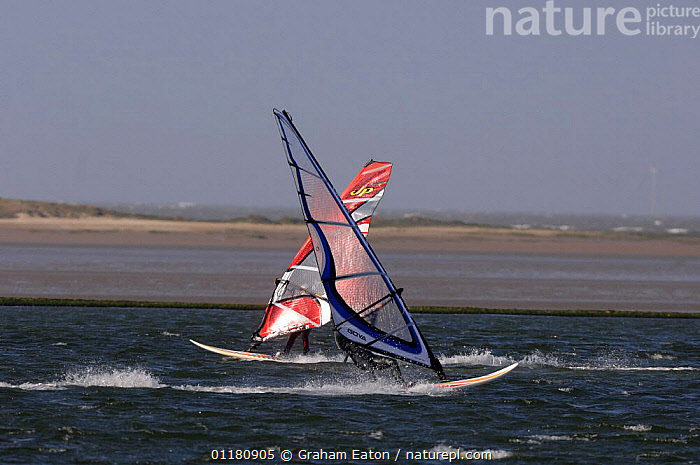 Windsurfers on a windy Marine Lake with Wind Turbines in the background, Wirral, March 2007, ACTION,COASTS,EUROPE,LEISURE,PEOPLE,SPORT,UK,WIND,WINDSURFING,United Kingdom,Weather,British,SPORTS, WATERSPORTS, United Kingdom, United Kingdom, Graham Eaton