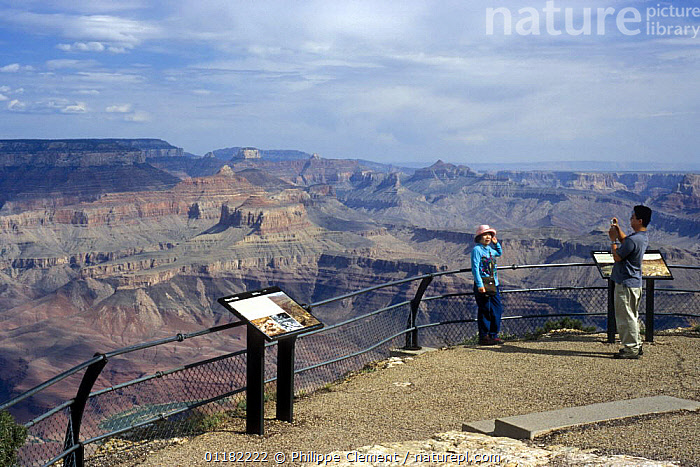Tourist posing in front of the Grand Canyon at viewpoint along the Desert View Drive, Grand Canyon NP, Arizona, USA  ,  EROSION,GEOLOGY,LANDMARKS,NORTH AMERICA,NORTH AMERICA,PEOPLE,RESERVE,ROCK FORMATIONS,ROCKS,TOURISM,USA  ,  Philippe Clement