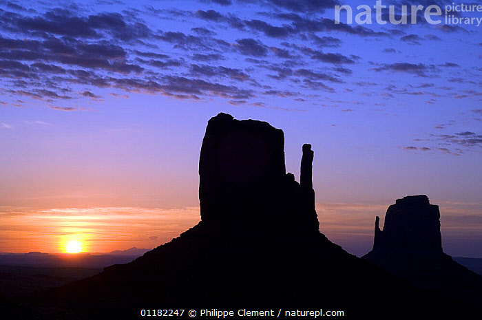 The Mittens at dawn, Monument Valley Navajo Tribal Park, Arizona, USA May 2007  ,  CLOUDS,EROSION,GEOLOGY,LANDSCAPES,NORTH AMERICA,NORTH AMERICA,RESERVE,ROCK FORMATIONS,ROCKS,SILHOUETTES,SUNRISE,USA,Weather  ,  Philippe Clement
