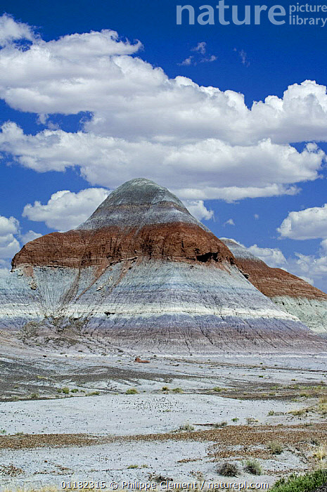 The Tepees / cones, Painted Desert and Petrified Forest NP, Arizona, USA May 2007  ,  CLOUDS,COLOURFUL,EROSION,LANDSCAPES,NORTH AMERICA,NORTH AMERICA,RESERVE,ROCK FORMATIONS,VERTICAL,Weather,Geology,USA  ,  Philippe Clement