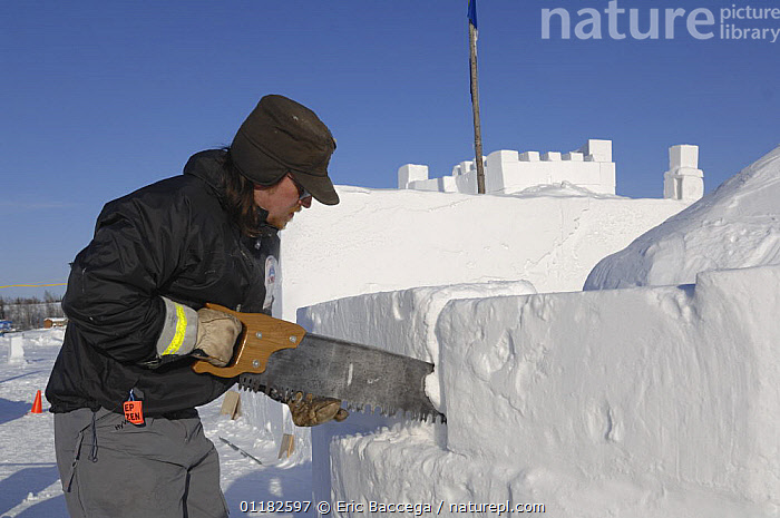 Carver working on the Snowking castle, which is built each winter from snow blocks. Yellowknife Bay, on Great Slave Lake, Northwest Territories, Canada. March 2007  ,  BUILDINGS,NORTH AMERICA,PEOPLE,WORKING  ,  Eric Baccega