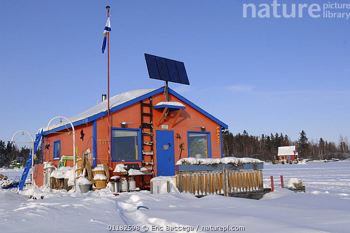Houseboat on frozen Yellowknife bay, Great Slave lake, Northwest Territories, Canada March 2007  ,  BOATS,BUILDINGS,HOMES,NORTH AMERICA,SNOW,WINTER,CANADA  ,  Eric Baccega