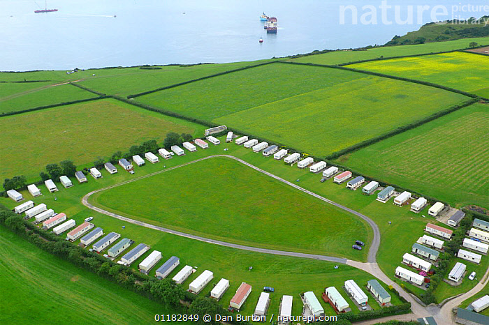 Aerial views of campsite anc caravan park near Sidmouth and Branscombe, Devon, UK, 2007 Note - shipwrecked 'Napoli' sitting off the coastline in background  ,  BUILDINGS,CAMPING,CARAVANS,COASTS,EUROPE,FIELDS,LANDSCAPES,TOURISM,UK,United Kingdom,British,ENGLAND, United Kingdom, United Kingdom  ,  Dan Burton