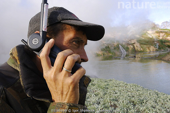 Photographer Igor Shpilenok reporting by satellite phone on events after major landslide in Valley of the Geysers, Kamchatka, Russia, June 3, 2007.  ,  ASIA,COMMUNICATION,GEYSERS,PEOPLE,PHONE,RUSSIA,TELEPHONE,CIS  ,  Igor Shpilenok