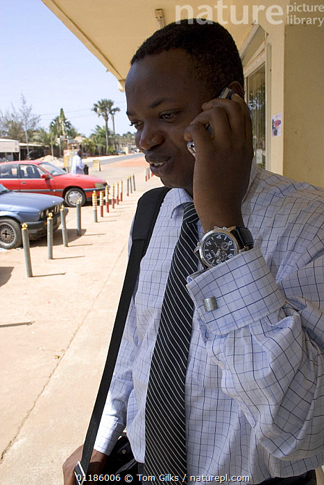 Gambian businessman using mobile phone, Gambia, 2007  ,  AFRICA,COMMUNICATION,PEOPLE,TELEPHONE,VERTICAL,WEST AFRICA,WEST-AFRICA  ,  Tom Gilks