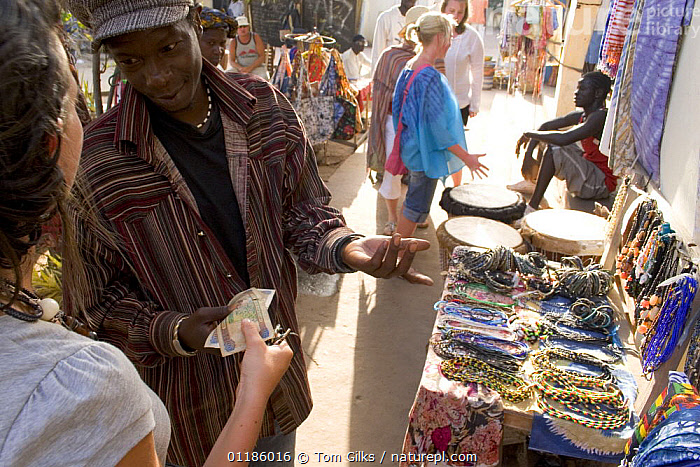 Tourists shopping at Senegambia craft market, Gambia, 2007  ,  AFRICA,MONEY,PEOPLE,TOURISM,TRADE,WEST AFRICA,WEST-AFRICA  ,  Tom Gilks