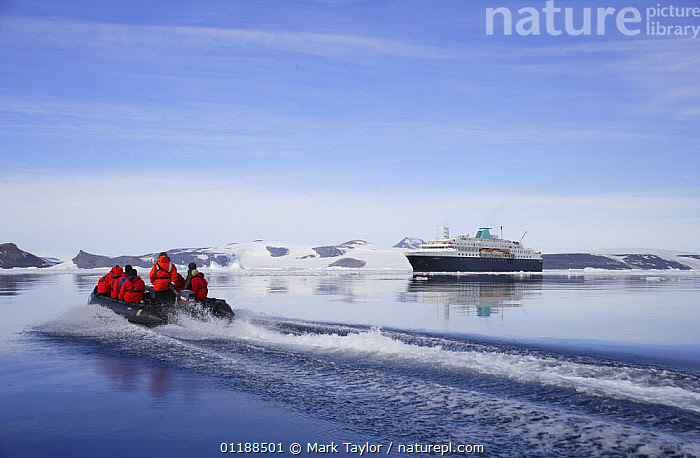 Tourists in zodiac boat with cruise ship in the background. Antarctica.  ,  ANTARCTICA,BOATS,LANDSCAPES,PEOPLE,POLAR,TOURISM  ,  Mark Taylor