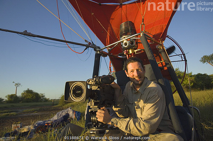 Cameraman Warwick Sloss in specially adapted hot air balloon, preparing to film Baobab trees in Morondava, Western Madagascar for BBC series  Planet Earth 'Forests'  ,  CAMERAS,DICOTYLEDONS,FILMING,MADAGASCAR,MALVACEAE,PLANTS,PORTRAITS  ,  Warwick Sloss