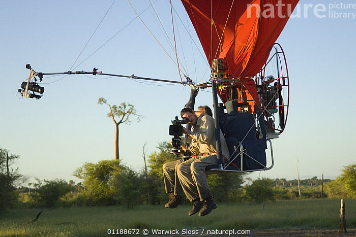 Cameraman Warwick Sloss in specially adapted hot air balloon, preparing to film Baobab trees in Morondava, Western Madagascar for BBC series  Planet Earth 'Forests'  ,  DICOTYLEDONS,FILMING,FLYING,MADAGASCAR,MALVACEAE,NHU,PLANTS  ,  Warwick Sloss