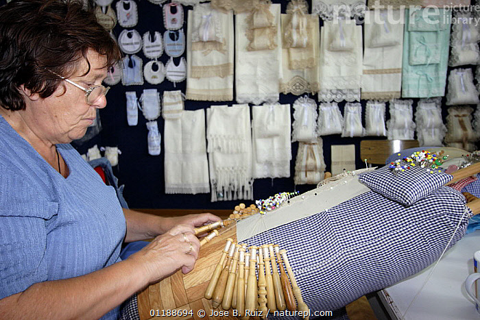 Woman working with lace bobbins in her workshop, Galicia, Spain  ,  crafts,craftsmanship,EUROPE,Handicraft,INDUSTRY,PEOPLE,SPAIN,TRADITIONAL  ,  Jose B. Ruiz