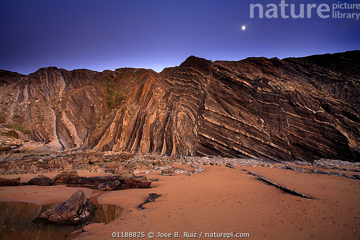 Folded rocks in the cliffs of Barrika Beach, Bilbao, Basque Country, Spain  ,  BAY OF BISCAY,BEACHES,CLIFFS,COASTS,DUSK,EUROPE,GEOLOGY,LANDSCAPES,MOON,PATTERNS,ROCK FORMATIONS,ROCKS,SPAIN,STRATA  ,  Jose B. Ruiz