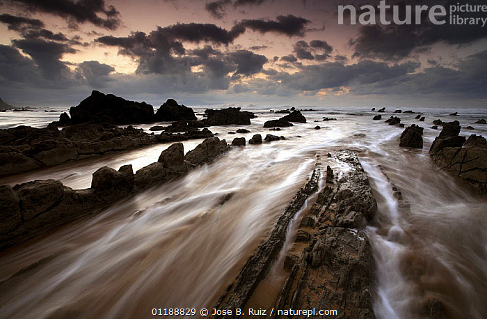 Waves rushing over rocks on Barrika Beach, Bilbao, Basque Country, Spain  ,  ARTY SHOTS,ATLANTIC OCEAN,BAY OF BISCAY,COASTS,EUROPE,GEOLOGY,LANDSCAPES,ROCKS,SPAIN,SUNSET,Marine  ,  Jose B. Ruiz