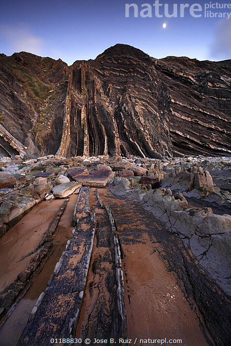 Folded rocks in the cliffs at Barrika Beach, Bilbao, Basque Country, Spain  ,  BAY OF BISCAY,BEACHES,CLIFFS,COASTS,EUROPE,GEOLOGY,LANDSCAPES,MOON,ROCK FORMATIONS,ROCKS,SPAIN,STRATA,VERTICAL  ,  Jose B. Ruiz