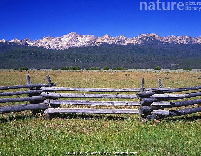 Fence with Sawtooth Mountains behind, Sawtooth NRA, Idaho, USA  ,  fences,LANDSCAPES,RESERVE,USA,North America  ,  Rob Tilley