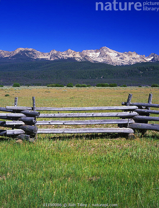 Fence with Sawtouth Mountains behind, Sawtooth NRA, Idaho, USA  ,  fences,LANDSCAPES,RESERVE,USA,North America  ,  Rob Tilley