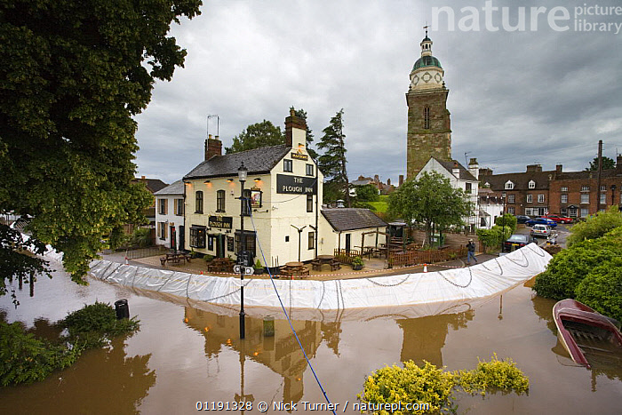 Temporary flood barriers erected around a pub at Upton-on-Severn, Worcestershire, June 2007  ,  ALLEVIATION,BARRIER,BOATS,BUILDINGS,DEFENCES,ENVIRONMENTAL,EUROPE,FLOODED,FLOODING,FLOODS,GLOBAL WARMING,HOUSES,LANDSCAPES,RIVERS,SEVERE,SUMMER,TOWNS,UK,WEATHER,United Kingdom,British  ,  Nick Turner