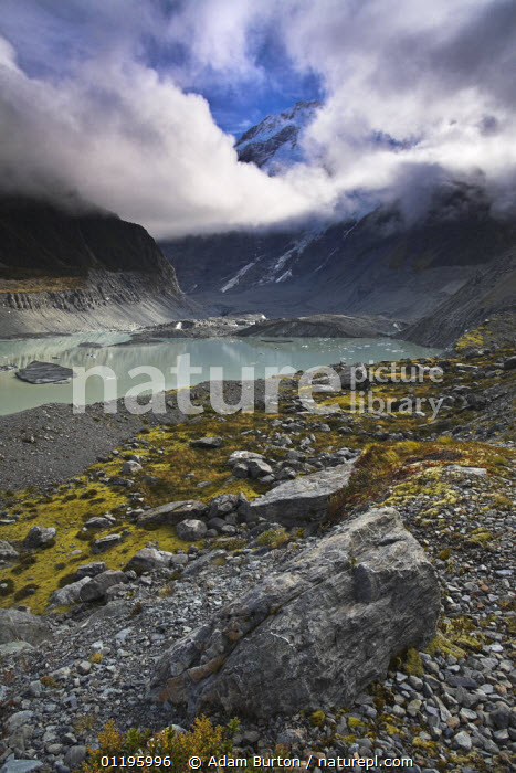 Glacial lake at toe of glacier in Mount Cook National Park, South Island, New Zealand  ,  AUSTRALASIA,CLOUDS,LAKES,LANDSCAPES,MOUNTAINS,NEW ZEALAND,NP,RESERVE,ROCKS,VERTICAL,Weather,National Park  ,  Adam Burton