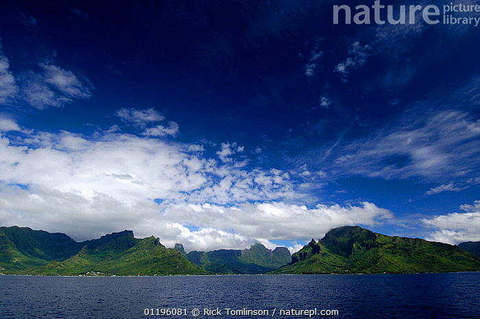 View of a volcanic island in French Polynesia, 2006.  ,  CLOUDS,COASTS,ISLANDS,LANDSCAPES,MOUNTAINS,PACIFIC ISLANDS,Weather  ,  Rick Tomlinson