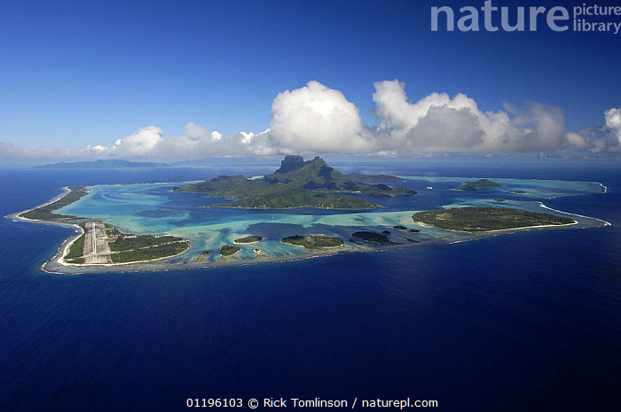 Aerial view of a volcanic island in French Polynesia  ,  AERIALS,airports,airstrip,CLOUDS,COASTS,ISLANDS,LANDSCAPES,PACIFIC ISLANDS,TROPICAL,Weather  ,  Rick Tomlinson