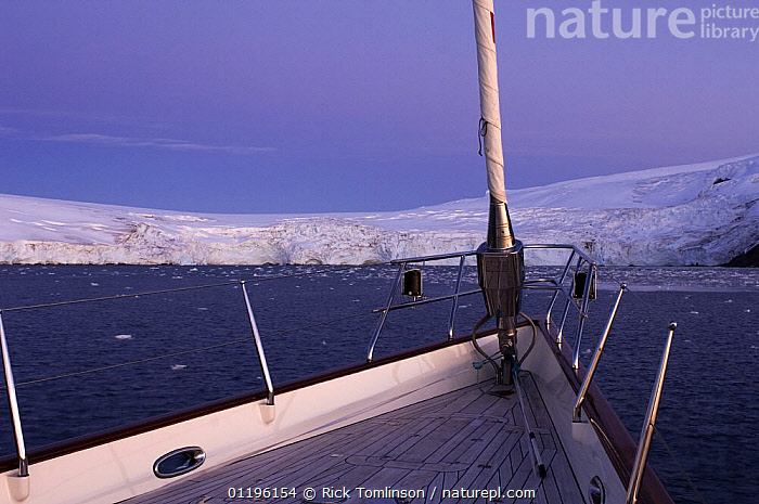 """Evening light on the bow of SY """"Adele"""", 180 foot Hoek Design, in Yankee Harbour, Antarctica, January 2007 Non editorial uses must be cleared individually.  ,  ABOARD,ANTARCTICA,BOATS,BOWS,COASTS,DUSK,FOREDECKS,forestay,forestays,furler,GUARD RAILS,ICE,KETCHES,POLAR,pulpit,pulpits,SAILING BOATS,SNOW,stanchion,stanchions,stays,SUPERYACHTS,YACHTS,BOAT-PARTS, SAILING-BOATS , SAILING-BOATS , SAILING-BOATS , SAILING-BOATS , SAILING-BOATS , SAILING-BOATS  ,  Rick Tomlinson"""