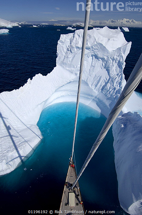 """Aerial view, taken from the mast, of SY """"Adele""""'s bow in the bay of an iceberg, Portal Point, Reclus Pennisula, Antarctica, January 2007 Non editorial uses must be cleared individually.  ,  ABOARD,ANTARCTICA,BOATS,BOWS,COASTS,CRUISING,FOREDECKS,Gerlache Strait,HIGH ANGLE SHOT,ICEBERGS,KETCHES,masthead,mast head,mastheads,POLAR,SAILING BOATS,shadows,SUPERYACHTS,VERTICAL,YACHTS, SAILING-BOATS , SAILING-BOATS , SAILING-BOATS , SAILING-BOATS , SAILING-BOATS  ,  Rick Tomlinson"""