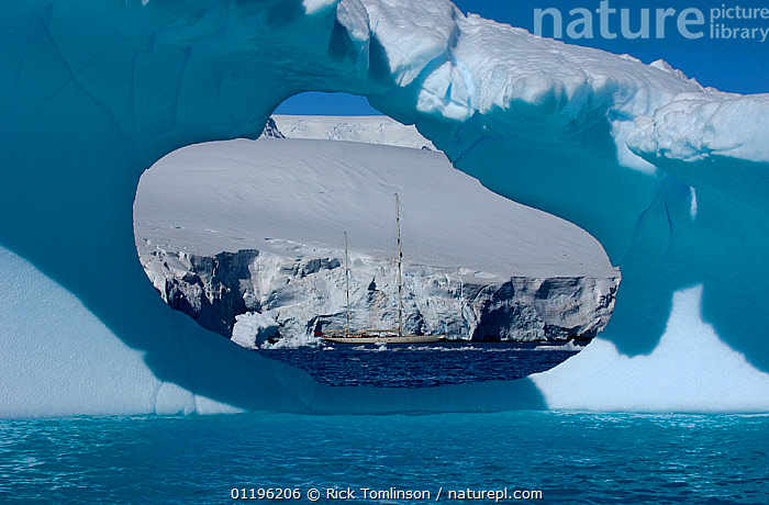 """SY """"Adele"""", 180 foot Hoek Design, seen in the distance through an ice window motoring in the Lemair Channel, Antarctica, January 2007 Non editorial uses must be cleared individually.  ,  ANTARCTICA,BOATS,COASTS,CRUISING,framed,hole,holes,ICE,ICEBERGS,KETCHES,POLAR,SAILING BOATS,SUPERYACHTS,YACHTS, SAILING-BOATS , SAILING-BOATS , SAILING-BOATS , SAILING-BOATS , SAILING-BOATS , SAILING-BOATS , SAILING-BOATS  ,  Rick Tomlinson"""