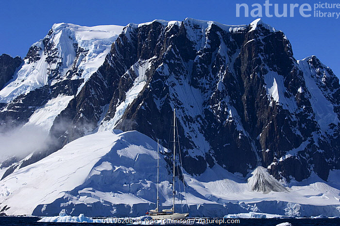"""SY """"Adele"""", 180 foot Hoek Design, dwarfed by dramatic mountains as she motors in the Lemaire Channel, Antarctica, January 2007 Non editorial uses must be cleared individually.  ,  ANTARCTICA,BOATS,CRUISING,HORIZONTAL,ICEBERGS,KETCHES,MOUNTAINS,POLAR,SAILING BOATS,SCALE,SIZE,SNOW,SUPERYACHTS,YACHTS, SAILING-BOATS , SAILING-BOATS , SAILING-BOATS , SAILING-BOATS , SAILING-BOATS , SAILING-BOATS  ,  Rick Tomlinson"""