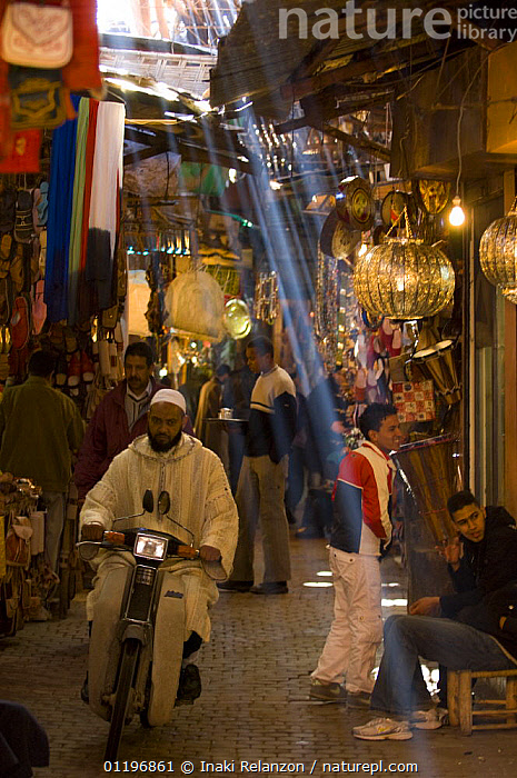 Medina, traditional market with rays of sunshine reaching the ground, narrow streets in old Marrakech, Morocco, North Africa  ,  AFRICA,CITIES,MARKET,MARKETS,NORTH AFRICA,PEOPLE,SOUK,TRADE,TRADITIONAL,TRANSPORT,VERTICAL,NORTH-AFRICA  ,  Inaki Relanzon