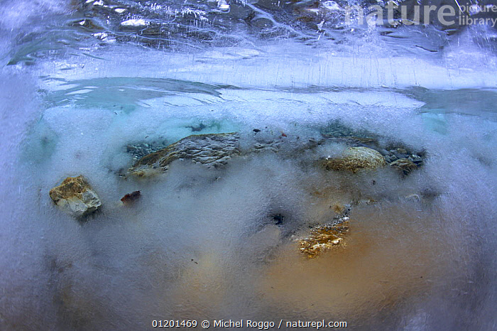 Underwater landscape in Hongrin River with ice on the river bed and surface in winter. Fribourg, Gruy�re, Switzerland, December, ABSTRACT,AQUATIC,EUROPE,FRESHWATER,GRUYERE,ICE,INTERESTING,LANDSCAPES,RIVERBED,RIVERS,ROCKS,SURFACE,TEMPERATE,UNDERWATER,WINTER, Michel Roggo