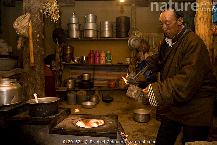 Man preparing sacrificial fire with juniper, Dargye, Sichuan, Tibet, China, ASIA,CEREMONIAL ,CEREMONY,CULTURES,INDOORS,KHAM,KITCHEN,KITCHENS,PEOPLE,TRADITIONAL,WORSHIP,CHINA, Dr. Axel Gebauer