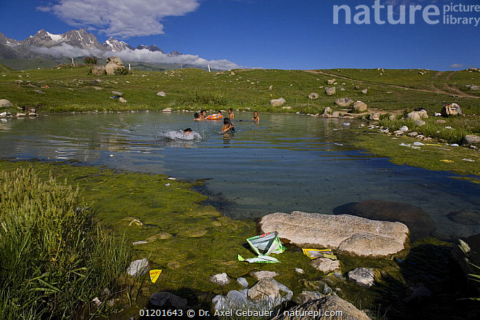 People bathing in hot spring in the mountains, with discarded rubbish, Dargye, Sichuan, Tibet, ASIA,GEOLOGY,GEOTHERMAL,KHAM,LAKES,LANDSCAPES,MOUNTAINS,PEOPLE,POLLUTION,POOLS,REFUSE,SPRINGS,CHINA, Dr. Axel Gebauer