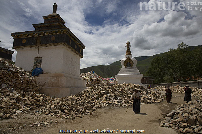 Gyanag Mani wall, with millions of Tibetan mani stones, is the largest in the world. Yushu, Qinghai Province, Tibet, China, ARTIFACTS,ASIA,BUDDHIST,BUILDINGS,CULTURE,LANDSCAPES,PEOPLE,RELIGION,TRADITIONAL,WALLS,WORSHIP,CHINA, Dr. Axel Gebauer