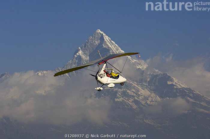 Microlight flight around Pokhara and towards the foothills of the Himalayas, Nepal. March 2008.  ,  AIRCRAFT,CENTRAL ASIA,FLYING,MOUNTAINS,PEOPLE  ,  Nick Garbutt