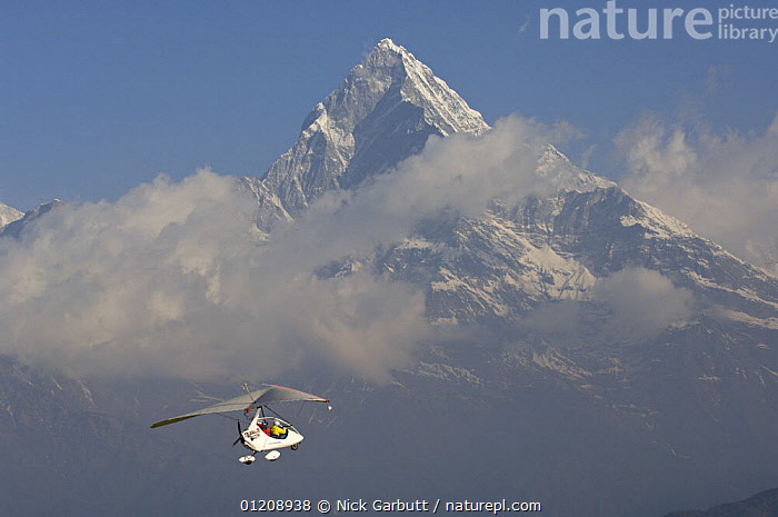 Microlight flight around Pokhara and towards the foothills of the Himalayas, Nepal. March 2008.  ,  AIRCRAFT,CENTRAL ASIA,CLOUDS,FLYING,MOUNTAINS,NEPAL,PEOPLE,Weather  ,  Nick Garbutt