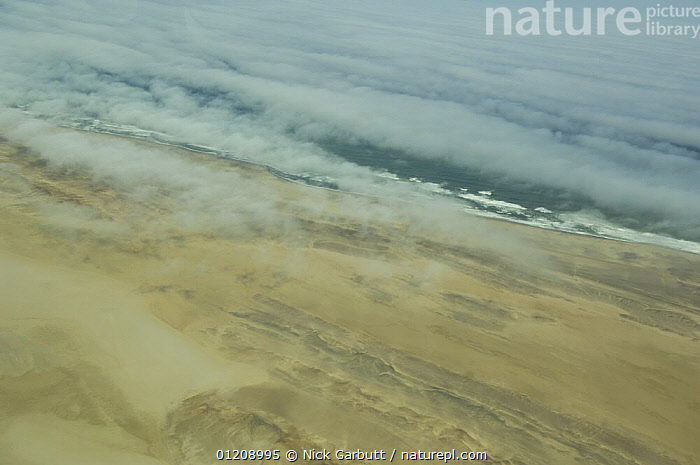 Coast of Namibia from the air with cloud and sea-mist, between Swakopmund and the Skeleton Coast. Namibia. July 2008.  ,  AERIALS,ARTY,CLOUDS,COASTS,SEA,SOUTHERN AFRICA,Weather  ,  Nick Garbutt