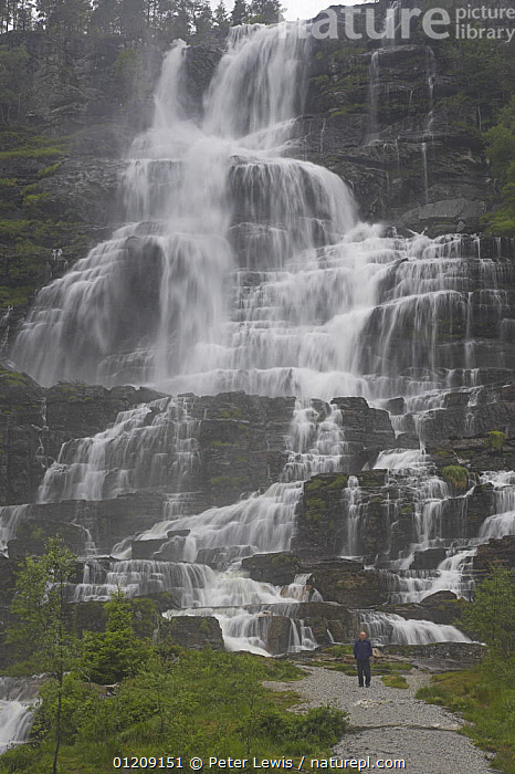 Man at base of Tvinnefossen, a 500ft high waterfall. Near Voss, Norway  ,  EUROPE,LANDSCAPES,MIST,PEOPLE,SCALE,SCANDINAVIA,SIZE,VERTICAL,WATERFALLS, Scandinavia,WEATHER , Scandinavia, Scandinavia, Scandinavia, Scandinavia, Scandinavia  ,  Peter Lewis